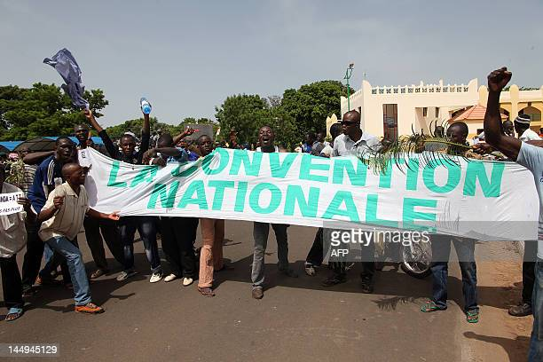 Some of thousands of Malians holding a banner reading 'The National Convention' protest on May 21 2012 in Bamako against a transition deal giving...