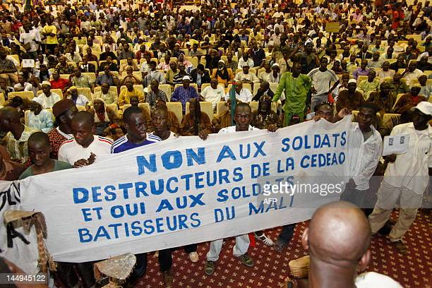 Some of thousands of Malians protest on May 21 2012 in Bamako a transition deal giving coup leader Amadou Sanogo the status of a former head of state...