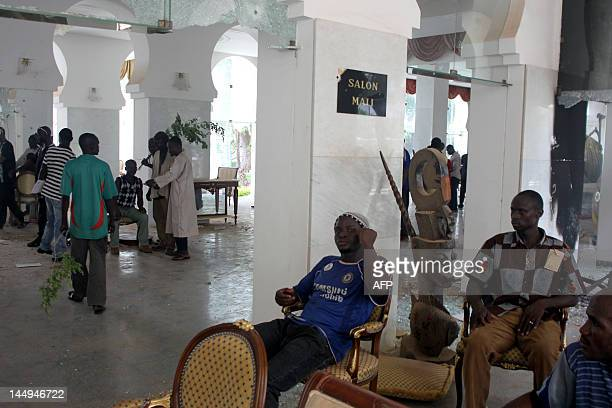 Some of thousands of Malians sit on May 21 2012 inside the presidential compound in Bamako during a protest against a transition deal giving coup...
