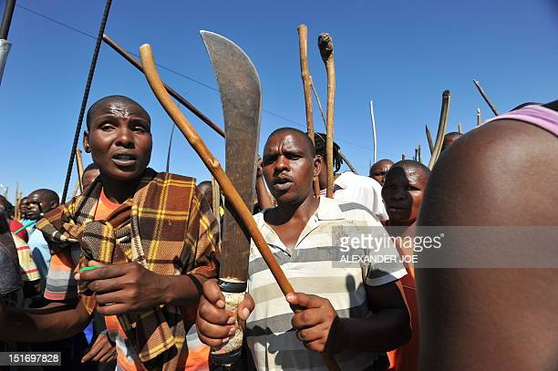 Some of thousands of South African mine workers walk on September 10 2012 to the Lonmin mine in Marikana to try and stop other miners from going to...