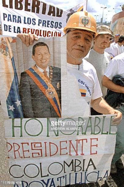 Some of thousands of supporters of Venezuelan President Hugo Chavez march 23 January 2003 in Caracas Organizers of the 53dayold strike urged...