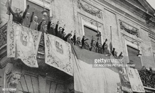 Some officials saluting Francoist troops from the balcony of the Real Casa de Correos as they march into the city, Madrid, Spain, Spanish Civil war,...