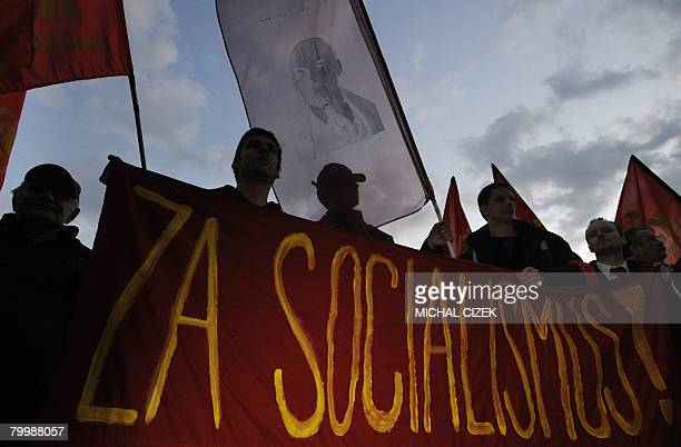 Some one hundred Czech communists holding flags and a portrait of Vladimir Ilyich Lenin demonstrate against the government and remember the February...