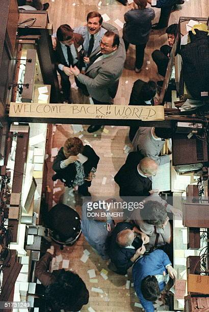 Some optimism shows on the floor of the New York Stock Exchange 28 October1987 both on faces and on a sign that traders posted that reads Welcome...