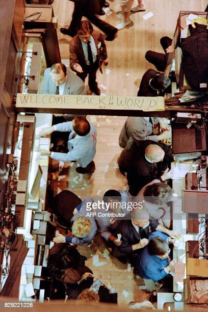 Some optimism shows on the floor of the New York Stock Exchange on October 28 1987 both on faces and on a sign that traders posted that reads...