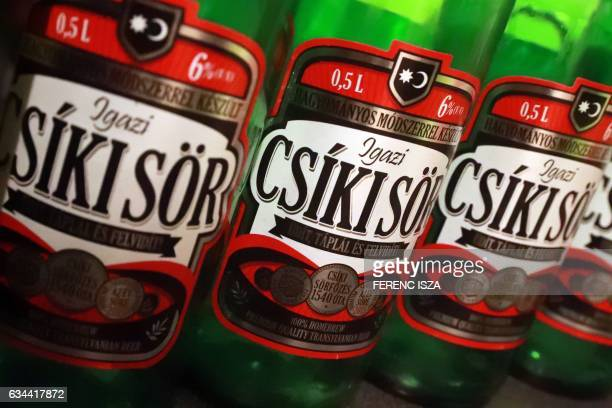 Some original bottles of Transylvanian made beer Csiki Sor from Romania is pictured in a Hungarian home in Budapest on February 9 2017 Hungary has...
