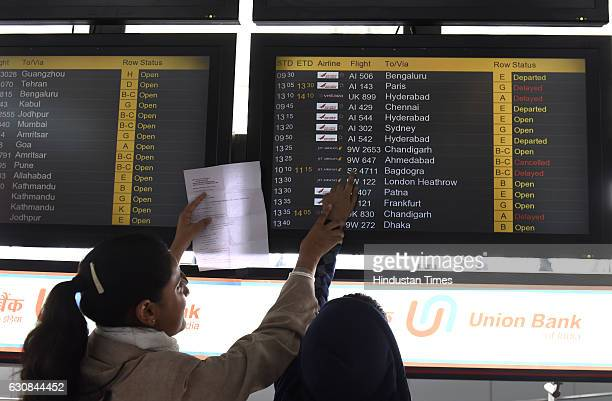 Some passengers had to wait to board their flight due to fog and bad weather at Indira Gandhi International Airport on January 3 2017 in New Delhi...
