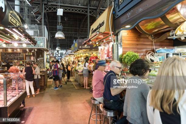 Some people are eating La boqueria Market, Barcelona