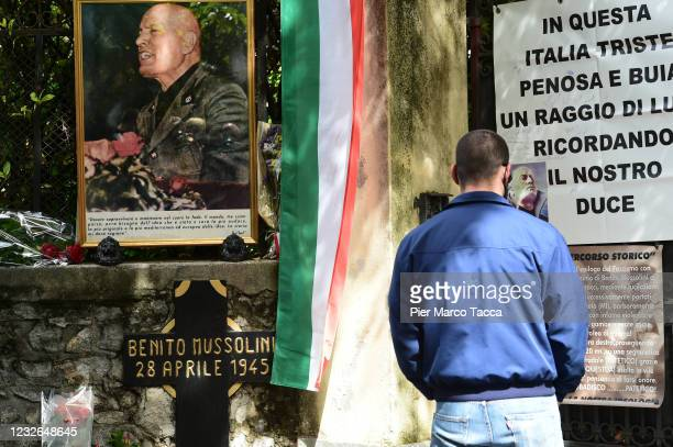 Some people attend the commemoration ceremony for the death of Italian dictator Benito Mussolini and his mistress, Claretta Petacci in front of a...