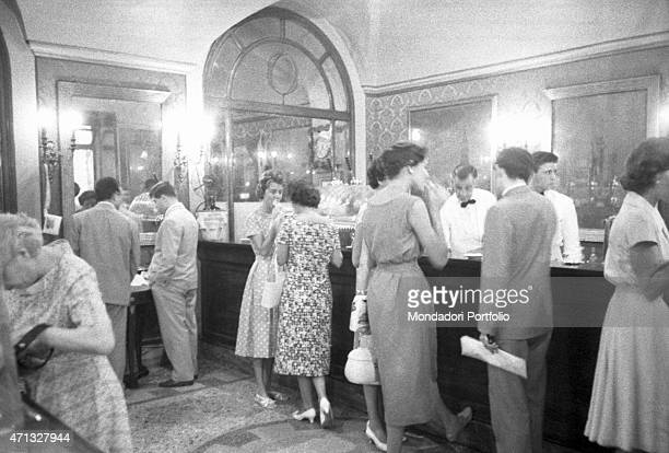 Some people chatting at the counter of the Antico CaffGreco on via Condotti Rome August 1958