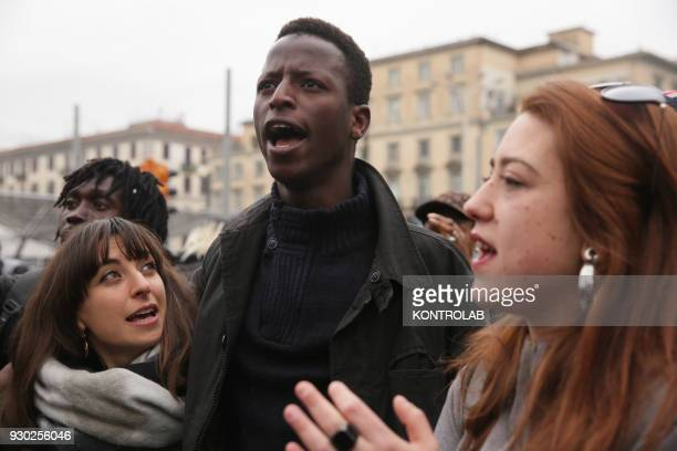 Some people during the demonstration that took place in Naples against racism and for Idy Diene a Senegalese street vendor killed in Florence