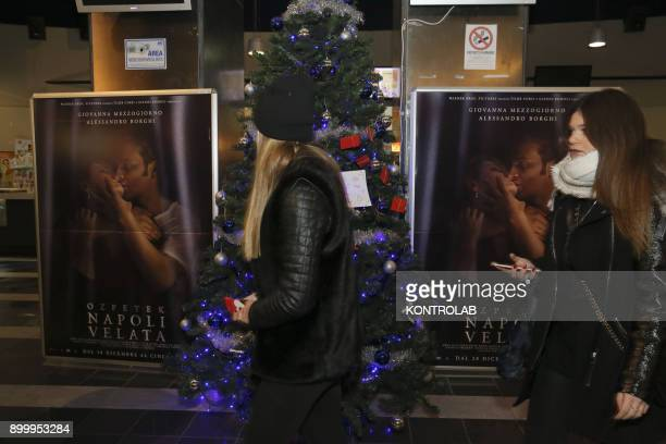 Some people in front of the film posters at the premier of 'Napoli Velata' directed by Ferzan Ozpetek main actors Giovanna Mezzogiorno and Alessandro...