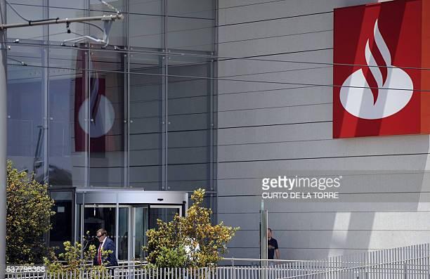 Some people leave a building of the Santander Bank's Financial City in Boadilla del Monte near Madrid on June 3 2016 / AFP / CURTO DE LA TORRE
