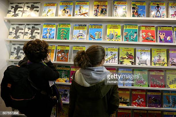 Some people look comic books in Angouleme 41st International Cartoonists Festival opening on January 30 2016 in Angouleme France