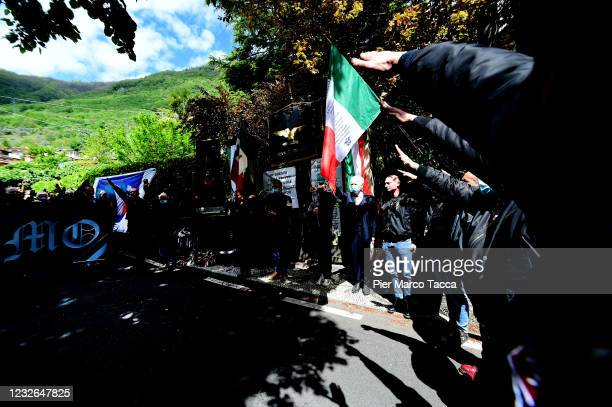 Some people make the fascist salute during the commemoration ceremony for the death of Italian dictator Benito Mussolini and his mistress, Claretta...