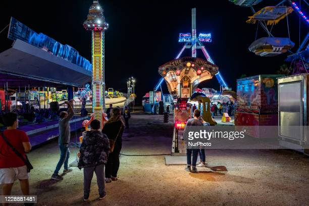 Some people play in an attraction of the Luna Park in Molfetta at Secca dei Pali on 3 October 2020 First day of opening of the Luna Park in Molfetta...