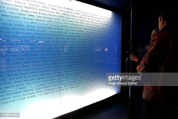 Some people read a number of messages posted by the citizens in the days following the attack in Atocha train station in Madrid at the memorial to...