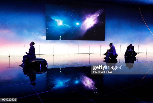 Some people sit at the Huawei stand at the Mobile World Congress the world's biggest mobile fair on February 26 2018 in Barcelona The Mobile World...