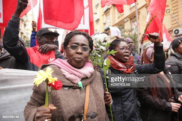 Some people with flowers during the demonstration that took place in Naples against racism and for Idy Diene a Senegalese street vendor killed in...