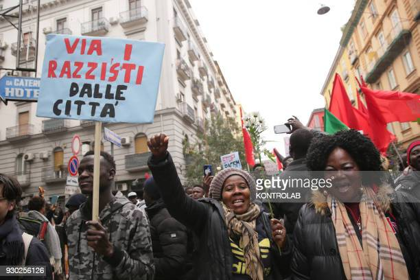 Some people with poster during the demonstration that took place in Naples against racism and for Idy Diene a Senegalese street vendor killed in...