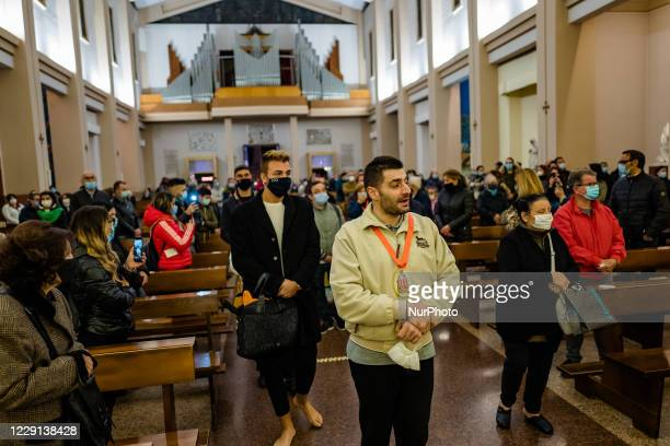 Some pilgrims from Bisceglie who came on foot from their city to honor the Santi Medici sing invoking the Saints in the Basilica Santuario of the...