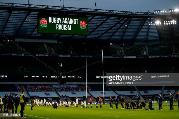 Some players stand and others take the knee in support of the Black Lives Matter movement ahead of the Six Nations rugby union match between England...