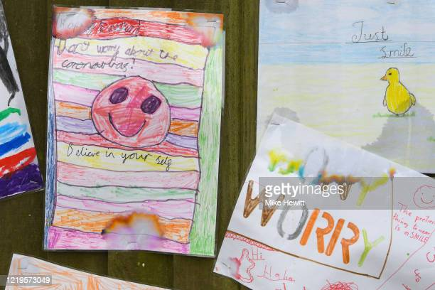 Some positive messages from local schoolchildren are pinned to a fence on April 18 2020 in Brighton United Kingdom In a press conference on Thursday...