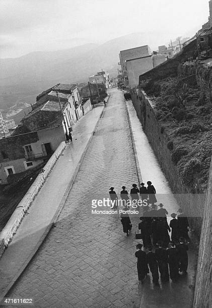 'Some priests walking in the street Agrigento December 1956 '