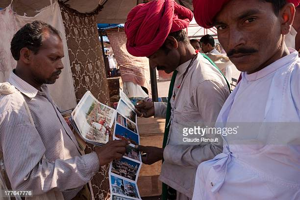 CONTENT] Some Rajasthani pilgrims buying postcards in Haridwar