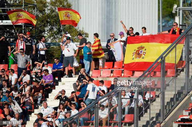 TOPSHOT Some Real Madrid fans wave Spanish flags during the Spanish league football match Girona FC vs Real Madrid CF at the Montilivi stadium in...