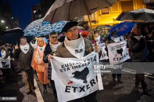 Some relatives of Basque prisoners carry banners reading 'Bring home Basque prisoners and fugitives' as they take part in a demonstration organised...