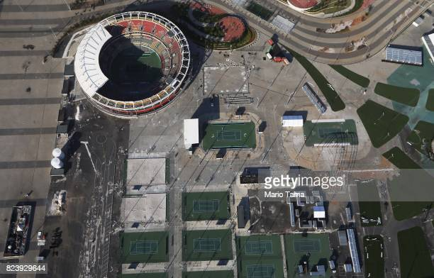 Some remaining tennis courts stand next to the main tennis stadium in Olympic Park in the Barra da Tijuca neighborhood on July 27, 2017 in Rio de...