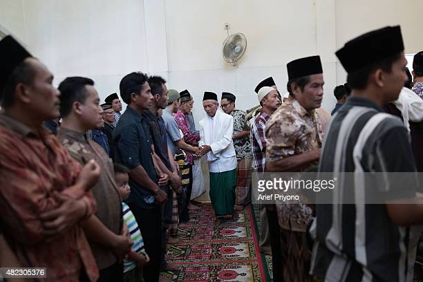 Some residents greet each other and apologize to each other after the 'Ketupat Feast' in Durenan villageCelebrating the 'Ketupat Feast' has been an...