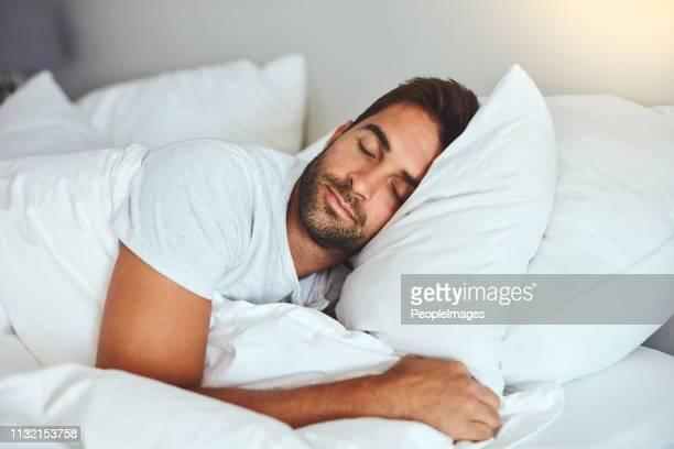 some rest after a hard day's work - dormir imagens e fotografias de stock