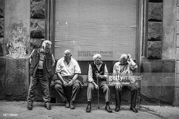 CONTENT] Some retired pensioners in Sienna being idle catching up on gossip watching tourists and locals pass by in the late afternoon