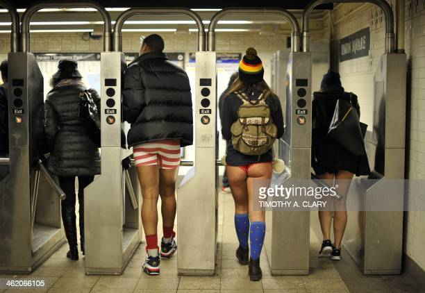 Some riders enter the New York subway in their underwear as they take part in the 2014 No Pants Subway Ride on January 12, 2014. Started by Improv...