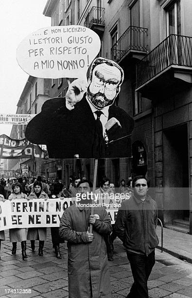Some RizzoliCorriere della Sera workers parading in the streets of the city One of the protesters holds a sign with the caricature of the President...