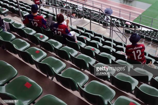 Some seats are taped to keep social distances prior to the J.League Meiji Yasuda J2 match between Fagiano Okayama and Giravanz Kitakyushu at the City...