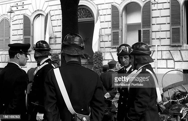 Some security force members in uniform await at the exit of a hotel the arrival of the car that will escort Princess Grace Kelly and her husband...