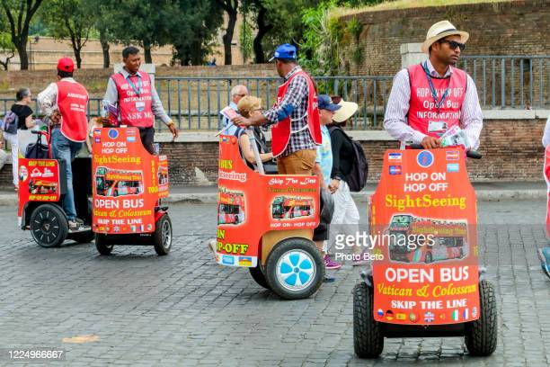 some segway tour guides offer tourist services near the vatican in rome - segway stock pictures, royalty-free photos & images