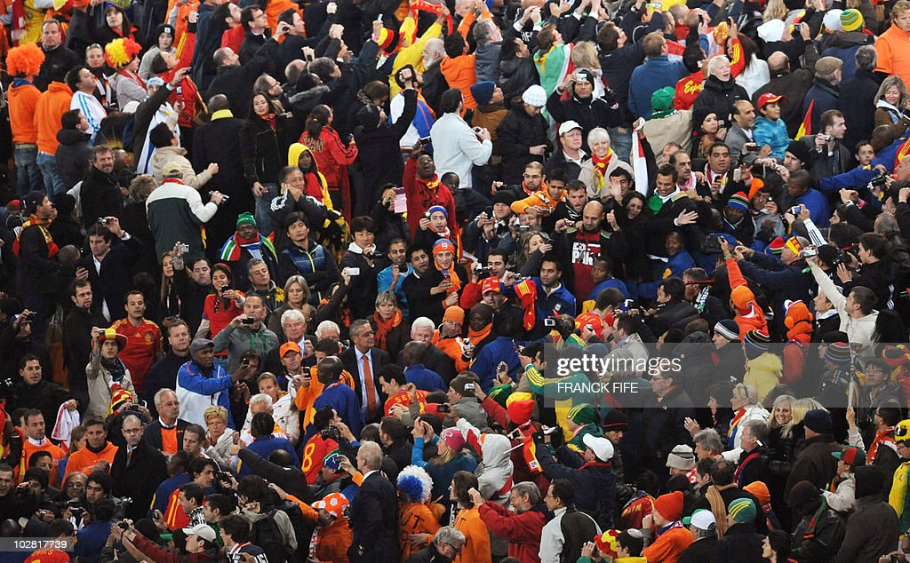 Some Spanish players celebrate with supporters following the 2010 World Cup final football match between the Netherlands and Spain on July 11, 2010 at Soccer City stadium in Soweto, suburban Johannesburg. NO