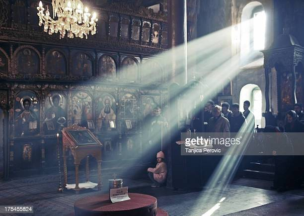 CONTENT] Some spectacular shafts of light rays inside the Orthodox Nativity church in Pirot Serbia present during the Holy Liturgy Service with a...