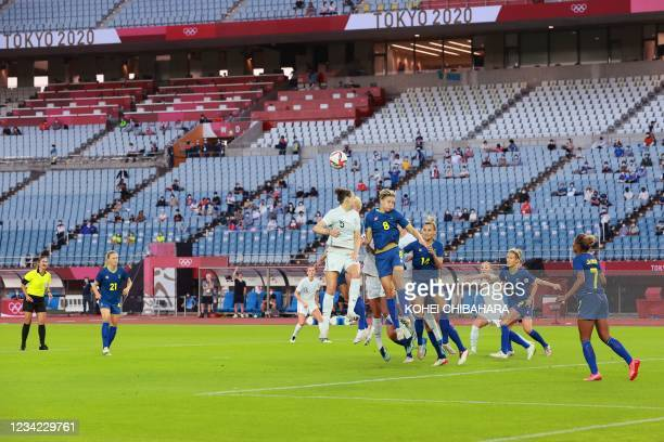 Some spectators are seen in the stands during the Tokyo 2020 Olympic Games women's group G first round football match between New Zealand and Sweden...