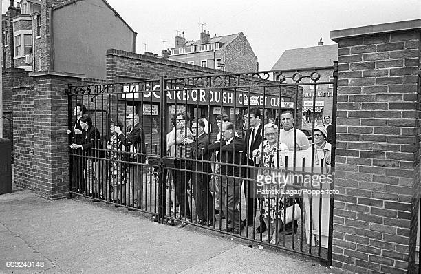 Some spectators prefer to watch the County Championship match between Yorkshire and Middlesex through the gates at Scarborough Yorkshire 21st July...