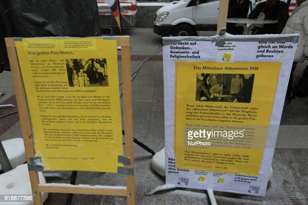 Some statements about Merkel and Hitler are shown by Pegida Munich at their stand The racist Pegida movement started to rally again in Munich Germany...