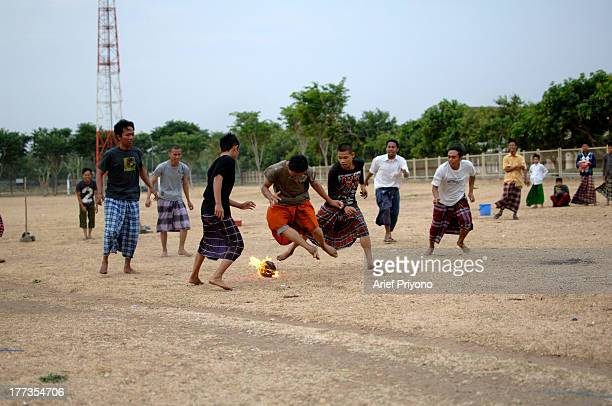 Some students play Fire Football at at an Islamic boarding school called Lirboyo Fire Football is a soccer game using a fireball made from a coconut...