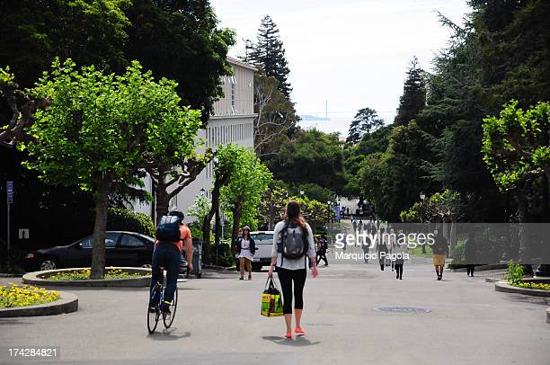 CONTENT] Some students walking around and some cyclists in the university campus at University of California Berkeley San Francisco California USA...