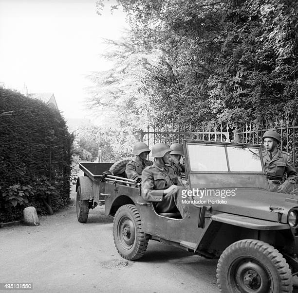 Some Swiss soldiers waiting for the orders on board a jeep during the proceedings of the Geneva Summit to discuss global security German unification...
