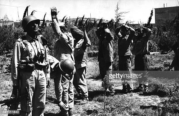 Some Syrian soldiers surrendering to an Israeli soldier during the SixDay War Palestine June 1967