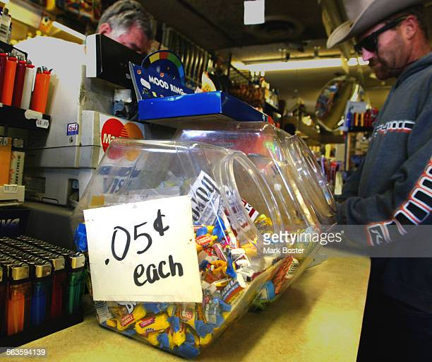 –Some things like a pack of bubblegum for a nickel still exist at Fred's Market in San ClementeFred Gunning and his wife Edith define the term mom...